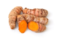 Group of turmeric roots isolated on white background